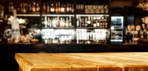 Fototapete - Wooden desk of bar and free space for your decoration.