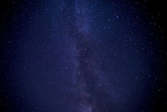 Low angle shot of a galaxy sky filled with stars at night time