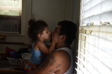 The Wider Image: Caring alone for two small girls, Texas father grapples with loss