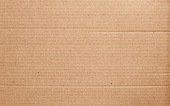 Brown cardboard sheet abstract background, texture of recycle paper box in old vintage pattern for design art work.
