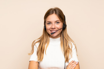Young blonde woman over isolated background working with headset