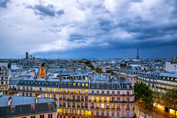 Poster de jardin Paris Dramatic sky with storm clouds over Paris, aerial panorama of Paris, France