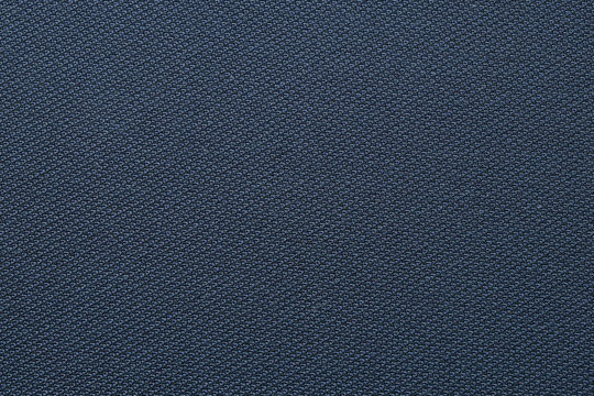 Close up shot of midnight dark blue formal suit cloth textile surface. wool fabric texture for important luxury evening or night event. Wallpaper and background with copy space for text