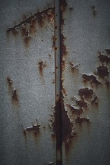 Closeup look of a rusty grey iron wall - a cool picture for wallpapers and backgrounds