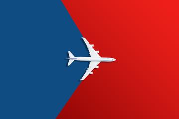 Airplane model. White plane on red background. Fotobehang