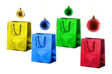 Variety paper shiny gift bags and christmas balls.