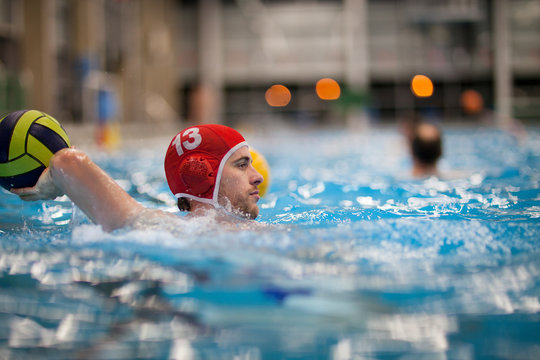 Water polo player in water throwing ball