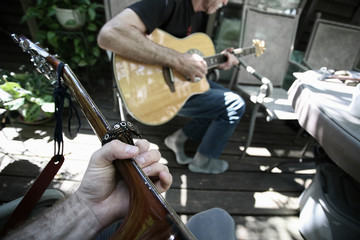 First person perspective playing guitar with another person.