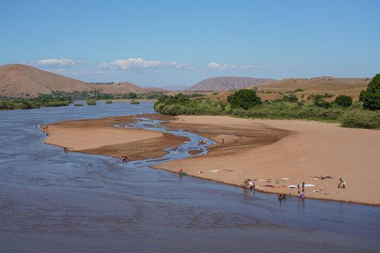 People washing clothes in the Manambolo River, Ambatolahy, Miandrivazo district, Menabe Region, Madagascar