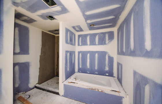 Construction remodeling a bathroom installation on interior drywall finish