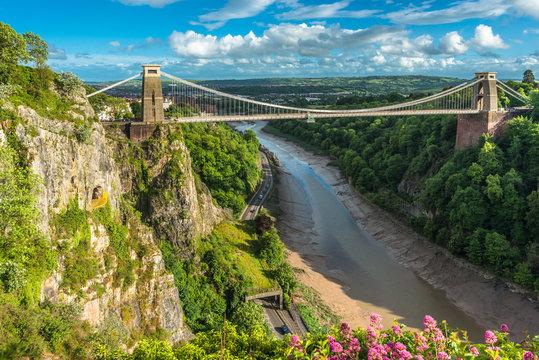 Historic Clifton Suspension Bridge by Isambard Kingdom Brunel spans the Avon Gorge with River Avon below, Bristol