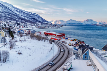 Aerial panoramic view of Tromso city area and it's marina in winter, North Norway.