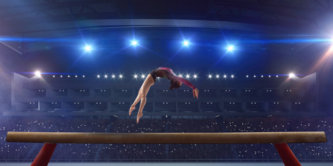 Female gymnast on professional arena.