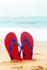beach shoes by the ocean