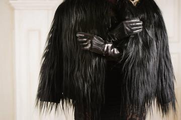 Girl in a black fur coat