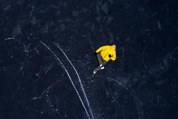 Man in yellow jacket in skates