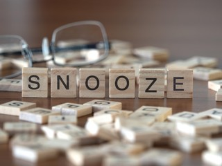 Aluminium Prints Chicken snooze the word or concept represented by wooden letter tiles