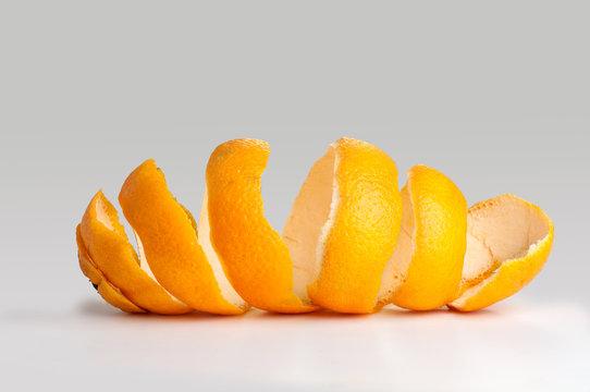 Peel of an orange spiral. twist on the peel. on gray background