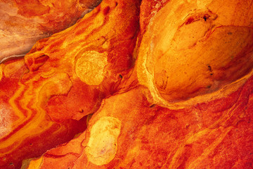 Foto op Aluminium Rood Detail of orange geoforms in Labetxu on Mount Jaizkibel, Basque Country