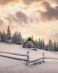 Foto auf AluDibond Weiß Fantastic winter landscape with wooden house in snowy mountains. Christmas holiday concept. Carpathians mountain, Ukraine, Europe