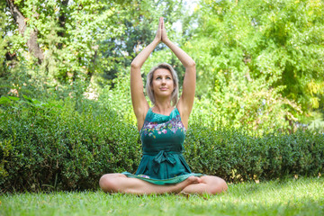the girl practicing yoga and practicing yoga postures, amazing yoga postures in grass