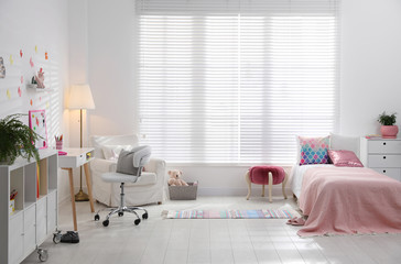Modern child room interior with comfortable bed