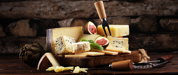 Different sorts of cheese. Cheese platter with different cheese and spice Fotobehang