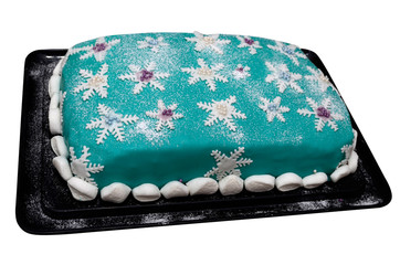 Christmas cake with snowflakes on a white