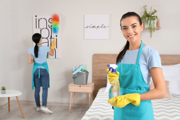 Team of janitors cleaning flat
