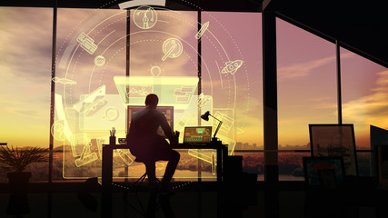At sunset, the designer works in the office on a background of infographics