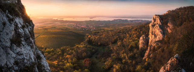 Aluminium Prints Autumn Colorful Autumn Sunset over Vineyards and Forest as Seen from Rocky Hill in Palava Protected Area near Mikulov in South Moravia, Czech Republic