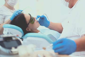 Dentist and his assistant carrying out a thorough examination