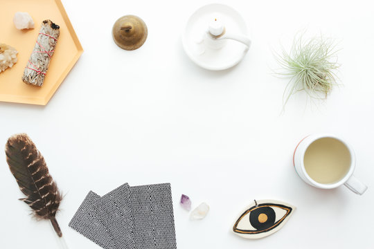 Tarot cards on a white background. Reading, feathers, crystals, tea.