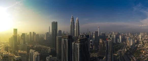 Aluminium Prints Kuala Lumpur kuala lumpur buildings with dramatic sunrise aerial panorama shot