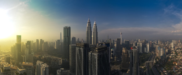 kuala lumpur buildings with dramatic sunrise aerial panorama shot