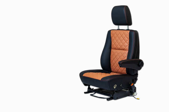 One sport seat of van with armrest with black and brown leather trim, located on the white isolated in the workshop for repair and tuning of cars and vehicles