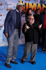 "Cast members Glover and DeVito attend the premiere for the film ""Jumanji: The Next Level"" in Los Angeles"