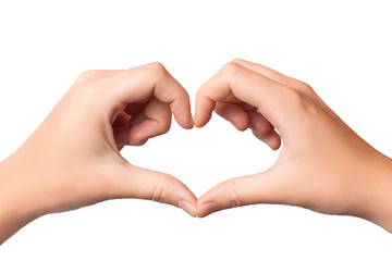 Woman's hands folded in the form of heart isolated on white background.
