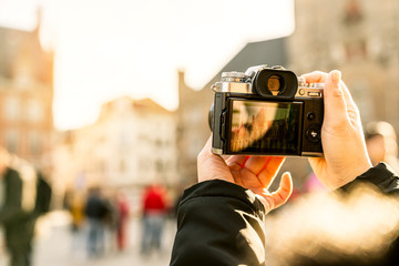 closeup asian woman hand hold retro camera traveller with background of old tradition architecture,asian photographer travel with retro camera