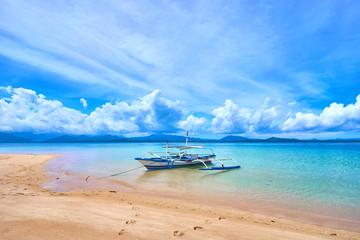 Asian fisher boat at stunning beach close to El Nido - Palawan - Philippines