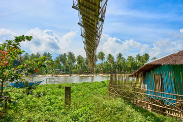 "Broken suspension bridge over ""Guinaraton River"" on Palawan - Philippines"