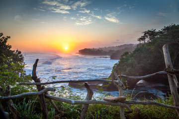 Zelfklevend Fotobehang Bali scenic sunset at balian westcoast of bali indonesia