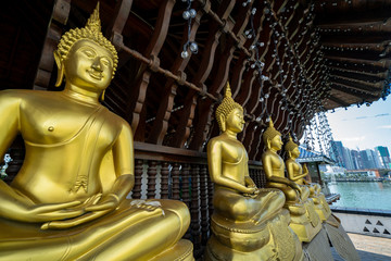 Golden Buddha statues at Seema Malaka Temple of Gangaramaya Buddhist Complex is a popular tourist spot and location in Colombo Sri Lanka