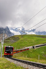 Swiss Mountain Train Returning to Station