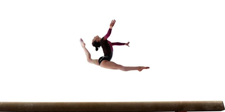 Female gymnast isolated on white.