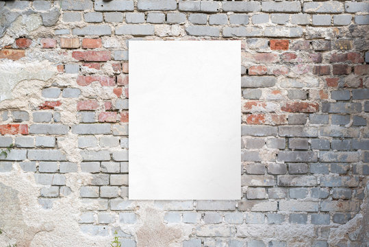 Poster mockup on an old brick street building wall. Clean, isolated paper for advertising presentation