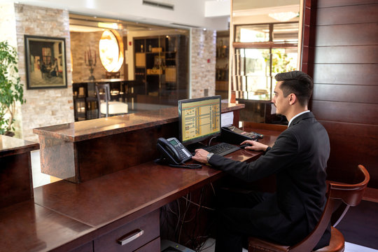Front desk hotel receptionist working