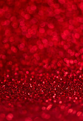 Abstract blur red glitter background card for Valentine's day, christmas and wedding celebration. Love bokeh sparkle confetti textured layout.