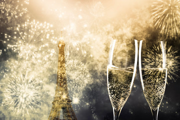 Poster Eiffeltoren two glasses of champagne and Eiffel tower with fireworks New Year in Paris