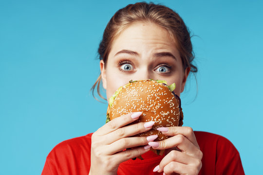 woman with hamburger